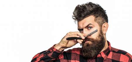 Bearded man, long beard, brutal, caucasian hipster with moustache. Vintage straight razor. Mens haircut in barber shop. Barber straight razor, barber shop
