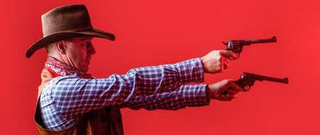 West, guns. Portrait of a cowboy. Western man with hat. Portrait of cowboy in hat. Man wearing cowboy hat, gun. Portrait of a cowboy