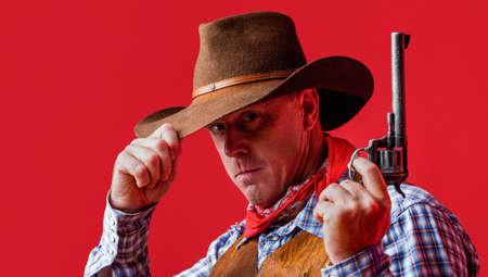 American bandit in mask, western man with hat. Man wearing cowboy hat, gun. West, guns. Portrait of a cowboy. American cowboy. Cowboy wearing hat. Western life. Guy in cowboy hat