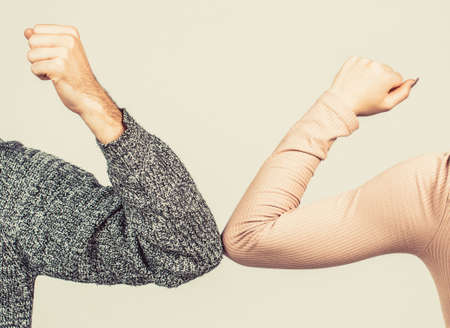 Elbows bump. Health care concept. Social distancing. Two people bump elbows to avoid coronavirus. Coronavirus epidemic. Closeup elbow bump Foto de archivo