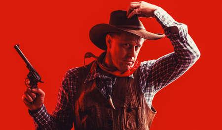 Portrait of man wearing cowboy hat, gun. Portrait of a cowboy. West, guns. Portrait of a cowboy. Western man with hat. Portrait of farmer or cowboy in hat. American farmer Reklamní fotografie