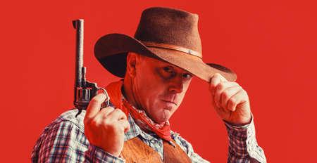 American bandit in mask, western man with hat. Man wearing cowboy hat, gun. West, guns. Portrait of a cowboy