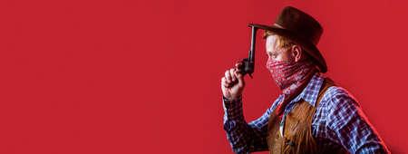 Portrait of a cowboy. American bandit in mask, western man with hat. Portrait of cowboy in hat. Portrait of man wearing cowboy hat, gun. Portrait of a cowboy. West, guns