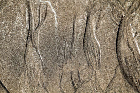 Sand texture created by waves Stock Photo