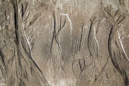 Sand texture drawn by waves Stok Fotoğraf