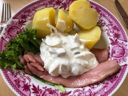 Matjes in apple yoghurt sauce Stock Photo