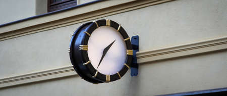 Clock at a house from a public place