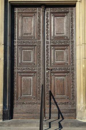 at an old wooden door
