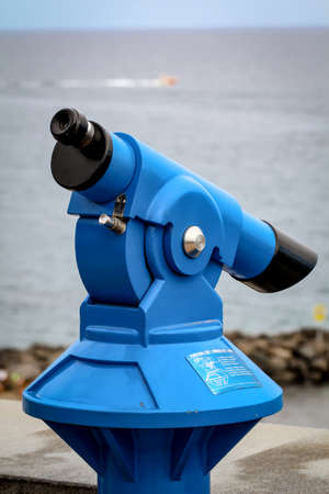 Telescope with a view of the beach