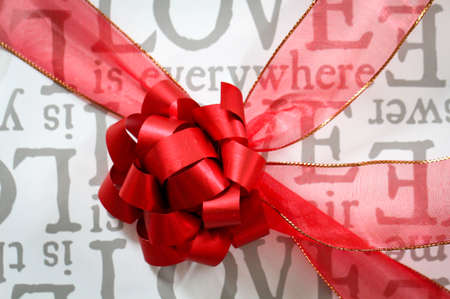 Gift box with wrapping paper and a red bow