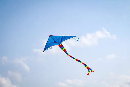 A kite rises in the strong wind in the baltic sea sky