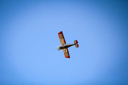 a small airplane in the blue sky
