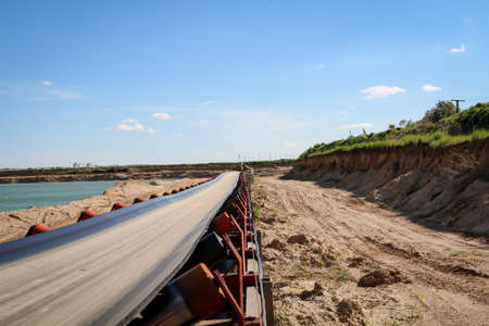 A string of transport belting in a gravel pit for transporting gravel and sand over long distances.