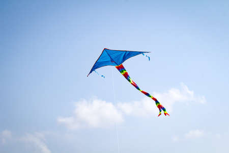 Blue stunt kite in the sky at the baltic sea