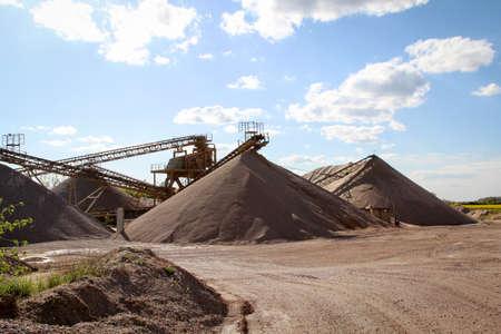 A string of transport belting in a gravel pit for transporting gravel and sand over long distances. Reklamní fotografie