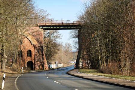 An old railway railway bridge over a road