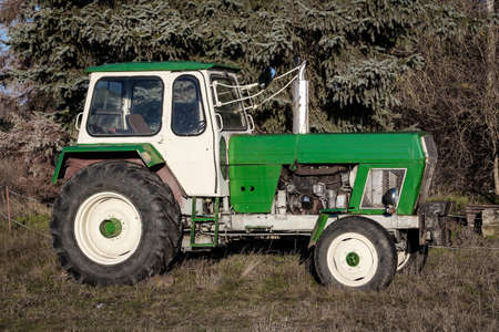A parked old tractor from the GDR Stock Photo