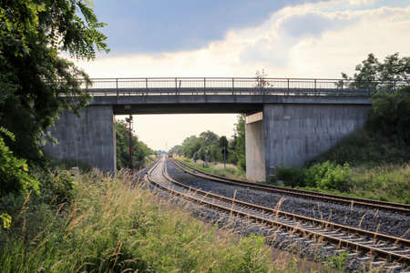 A bridge leads over railroad tracks