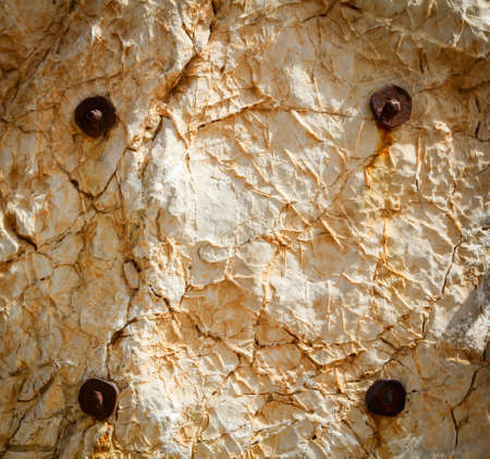 Stone texture with anchor bolts, texture of stone and iron
