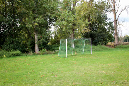 A soccer goal stands lonely on a sports field Foto de archivo - 134800133