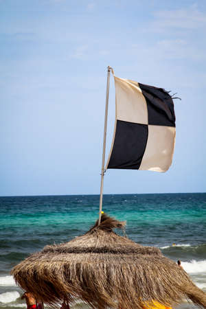 Flags on the beach indicate dangers like jellyfish, undercurrent and other dangers
