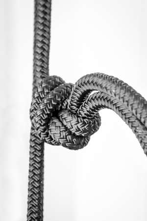 A rope with a knot, close up of a knot in the rope
