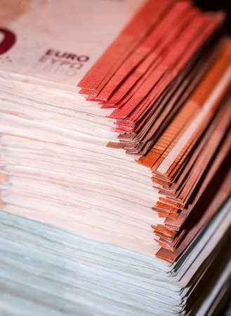 Several thousand euros in banknotes, banknotes bundled on a pile