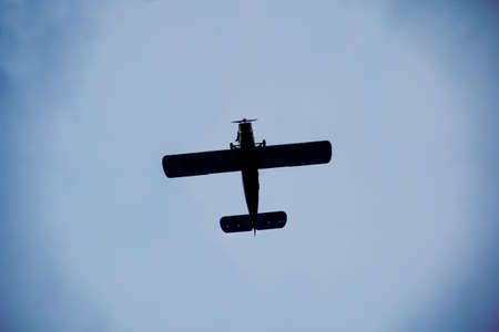 A biplane in the sky, probably AN 2