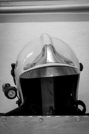 Helmets of firefighters, fire helmet are at hand parked