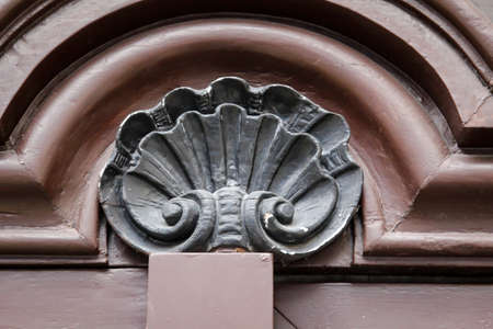 A beautiful wooden ornament on top of a wooden door