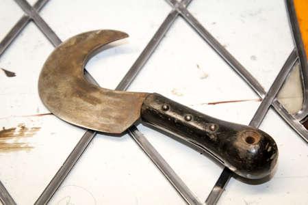 Tool of a glazier, lead glazing tools on a lead glass pane