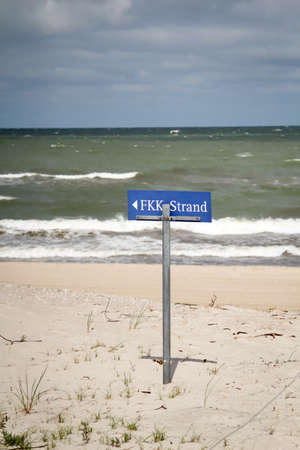 Sign indicating where to go to the FKK nudist section on the Baltic Sea