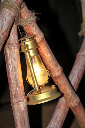 A petroleum lamp illuminates a path
