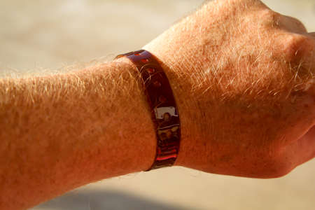 A VIP band or a band for all inclusive on one wrist