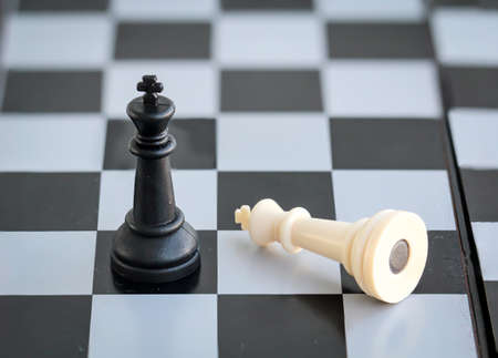 Chess pieces placed on a game board, game over Reklamní fotografie