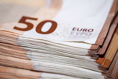 Many banknotes on a stack, euro notes bundled 스톡 콘텐츠