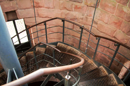 A spiral staircase in a tower-like building
