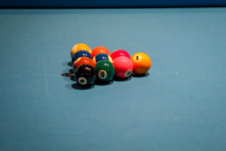 Scenes from billiards, colorful numbered balls on tables and other utensils