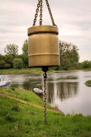 An old bell with which the ferryman was called on the Elbe.