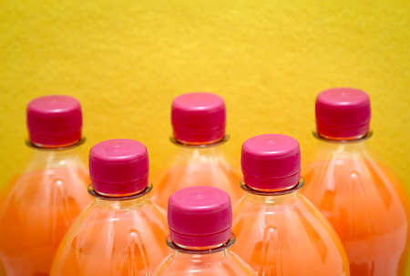 Beverage bottles with red lid, screw cap