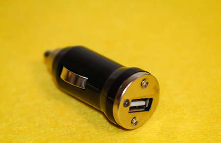 A USB charging plug for the cigarette lighter in the car