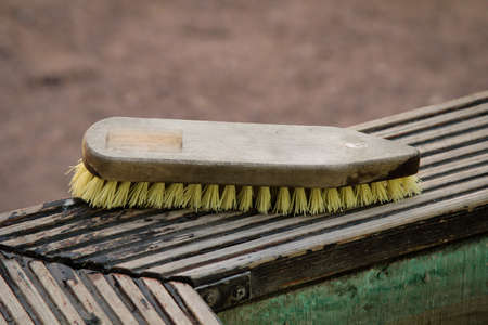 A cleaning brush for the shoes of players coming from the golf course