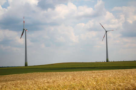 Wind turbines in a field generate green electricity.