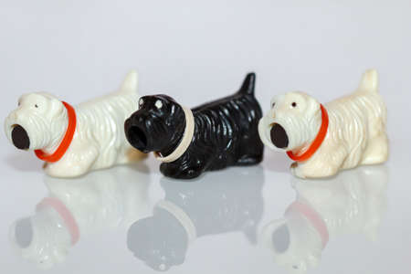Three small plastic dog toys. These originate from the middle GDR period.