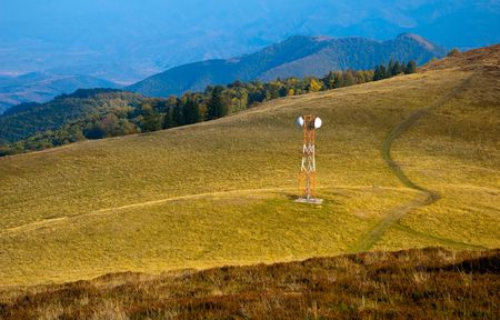 Telecommunication antenna (GSM) on mountain meadow pictured in autumn Stock Photo