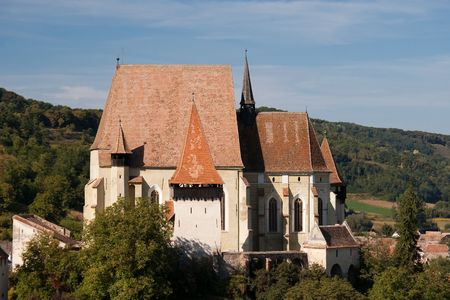 Fortified church in with defense wall and tower  Biertan Transylvania overlooking the village in a beautiful summer day Stock Photo