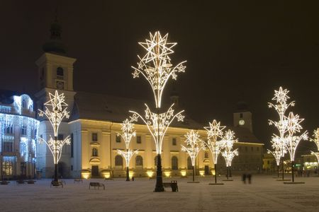 christmas lights in main square of sibiu transylvania with illuminated church and snow
