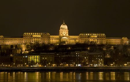 budapest by night long exposure winter danube shore beautiful public lighting on building photo