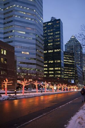 city street in winter dusk downtown business skyscrapers montreal lights reflecting on the wet asphalt photo