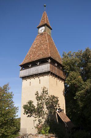 clock tower defense luteran fortified church Biertan Transylvania Romania  photo